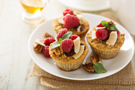 blueberry muffin: Homemade freshly baked healthy oatmeal muffins with berries and coconut Stock Photo