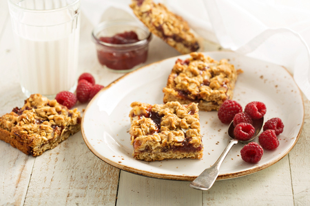 Almond oats and raspberry jam bars with crumble topping