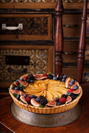 apple tart: Traditional french apple tart decorated with fresh fruit and berries