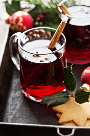 Christmas mulled wine in glass mugs with ginger cookies