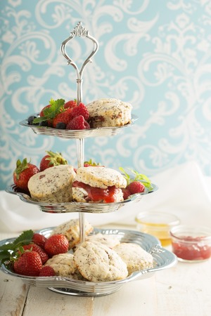 English scones with poppy seed served with strawberry jam