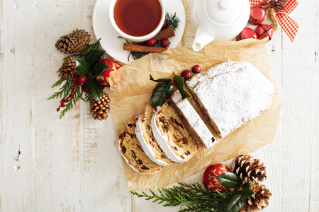Traditional Christmas stollen with decorations overhead shot