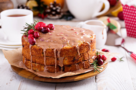 Christmas cake with ginger and cranberry and cinnamon glaze Stock Photo