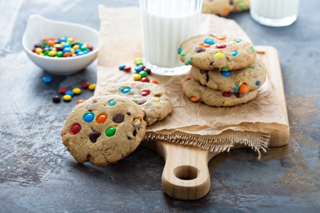 Chocolate chip and candy cookies with milk Stock Photo