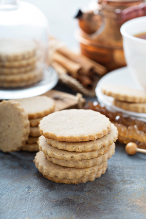 Cinnamon cut out cookies with tea on the table