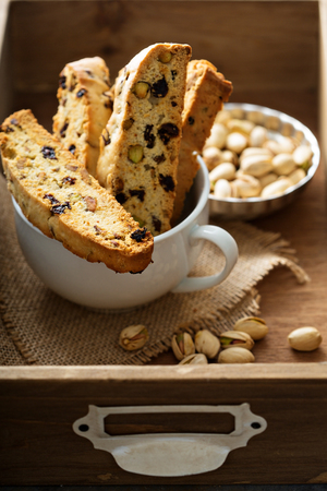 Homemade biscotti with dried fruits and nuts in a big cup Banco de Imagens - 65003537