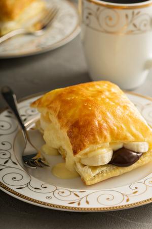 Puff pastry stacks with banana, vanilla custard and chocolate