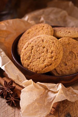 Seasonal cinnamon snickerdoodle cookies with tea in rustic setting 스톡 콘텐츠