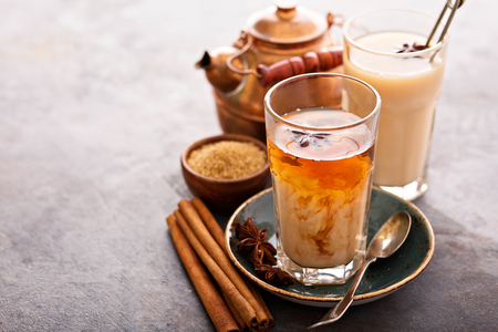 Hot masala chai, tea with spices and brown sugar Stock Photo