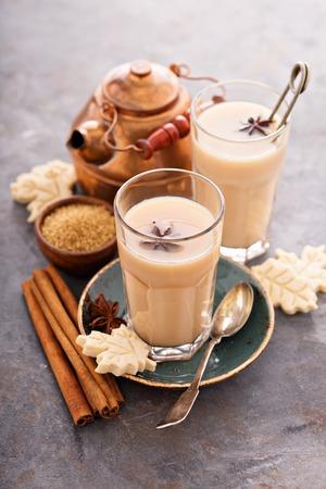 Hot masala chai, tea with spices and brown sugar Banco de Imagens