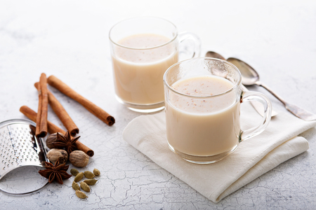Masala tea with winter spices in two glass mugs