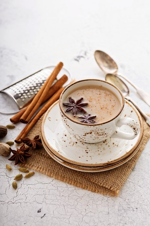 Masala tea in ceramic cup with winter spices