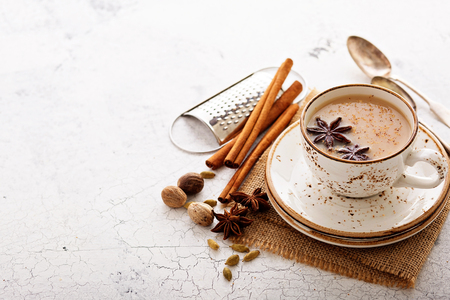Masala tea in ceramic cup with winter spices 写真素材 - 122038323