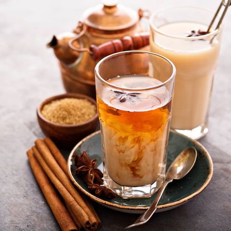 Hot masala chai, tea with spices and brown sugar 스톡 콘텐츠