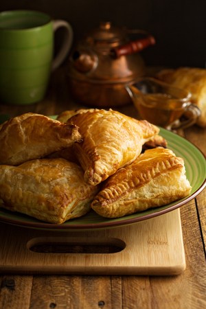 Freshly baked homemade cheese savory pastries in rustic setting Stock Photo - 122038366