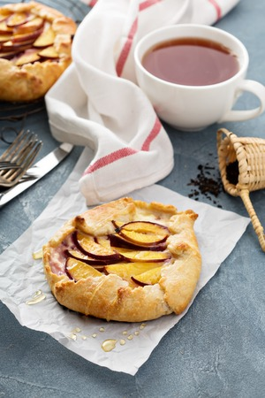 Open pie with plums and shortbread pastry 写真素材