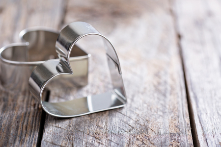 Heart shaped cookie cutter on wooden table, Valentines day baking concept Standard-Bild - 122038464