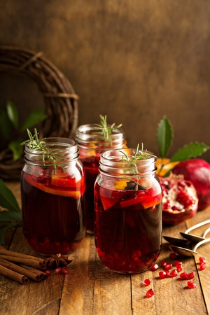 Pomegranate and orange winter or autumn cocktail, punch or sangria in mason jar Stock Photo