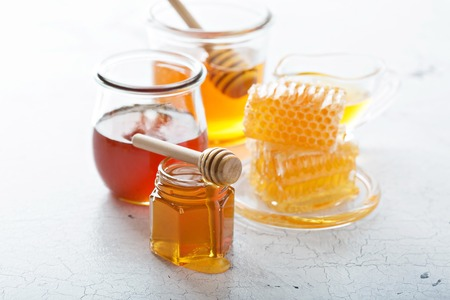 Various types of honey and honeycomb Stock Photo