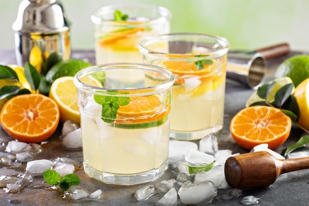 Refreshing summer cocktail with citrus fruits