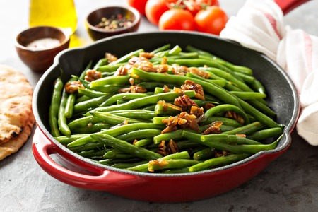 Green beans with caramelized pecans Stock Photo