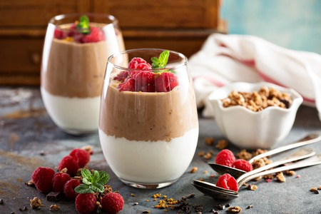 trifle: Breakfast parfait with yogurt and chocolate smoothie Stock Photo