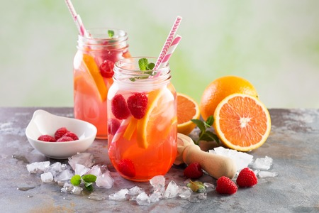 Pink berry lemonade or cocktail Фото со стока