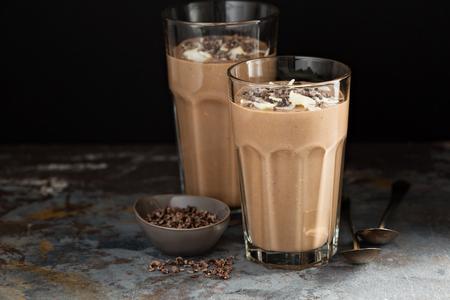 Chocolate banana smoothie with cocoa nibs Standard-Bild
