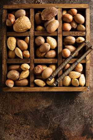 Various nuts in shell in a wooden box