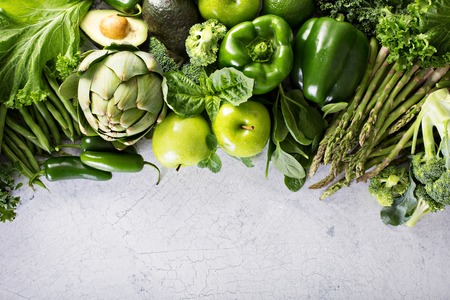 Variety of green vegetables and fruits copyspace on white Stock Photo