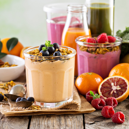 Orange mango smoothie with granola
