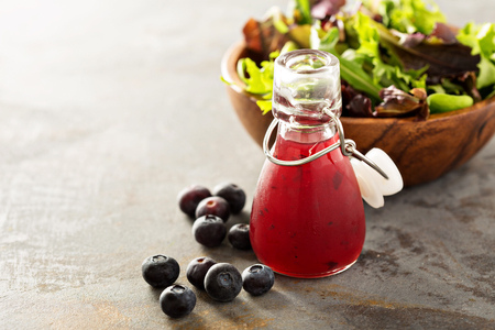 Blueberry vinaigrette salad dressing in small bottle