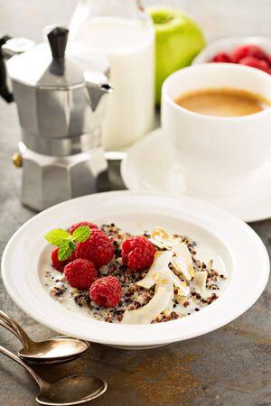 Quinoa porridge with raspberry and coconut flakes for breakfast