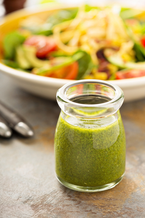 wholegrain mustard: Healthy green goddess salad dressing with herbs, garlic and olive oil