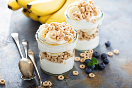 Yogurt parfait with cereal, banana and maple syrup