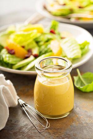 wholegrain mustard: Homemade honey mustard salad dressing in a jar