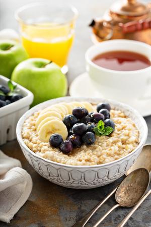 oatmeal: Steel cut oatmeal porridge with banana and blueberry