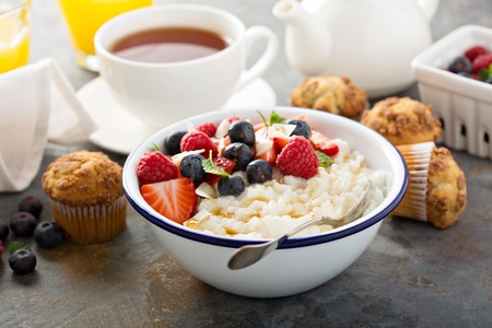Rice pudding with fresh berries and coconut for breakfast