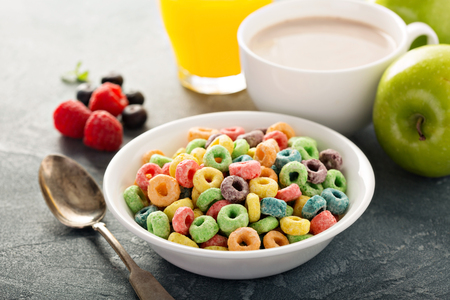 Fruit colorful sweet cereals with juice and cocoa