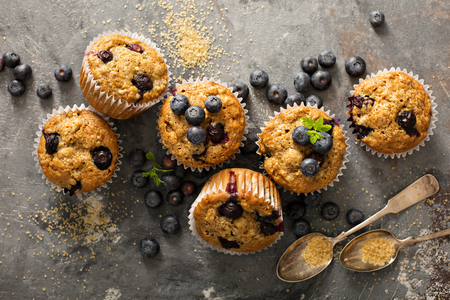 Healthy vegan banana blueberry muffins with fresh berries overhead shot