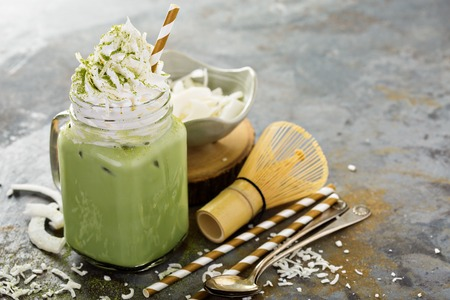 Iced matcha latte with coconut whipped cream