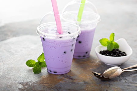 Berry bubble tea in plastic cups with lids and straws Stock Photo