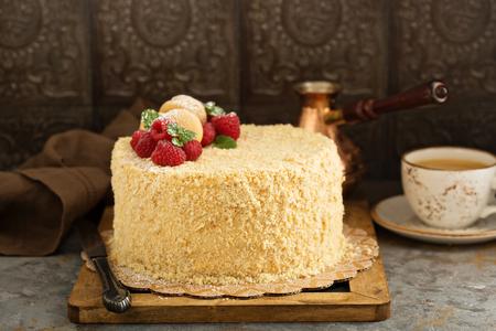 Napoleon layered cake with macarons and raspberry
