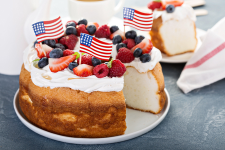 Angel food cake with whipped cream and fresh berries Stock Photo