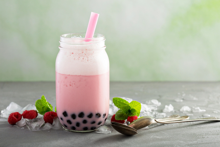 Strawberry bubble tea in mason jar with thick straw