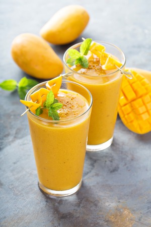 Mango smoothie in tall glasses