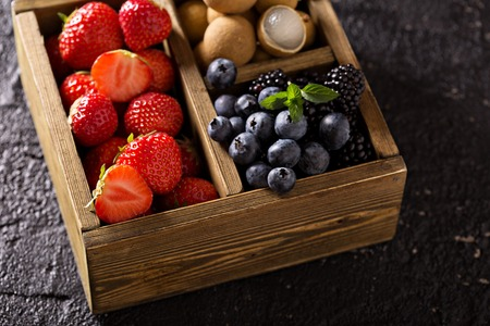 Fresh fruits in wooden box, strawberry, longan and blueberry Reklamní fotografie