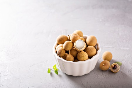 Longan fresh exotic tropical fruit in white bowl Stock Photo