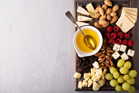 roquefort: Cheese plate with nuts, honey, raspberry and grapes