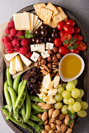 roquefort: Cheese plate with fresh vegetables and fruits